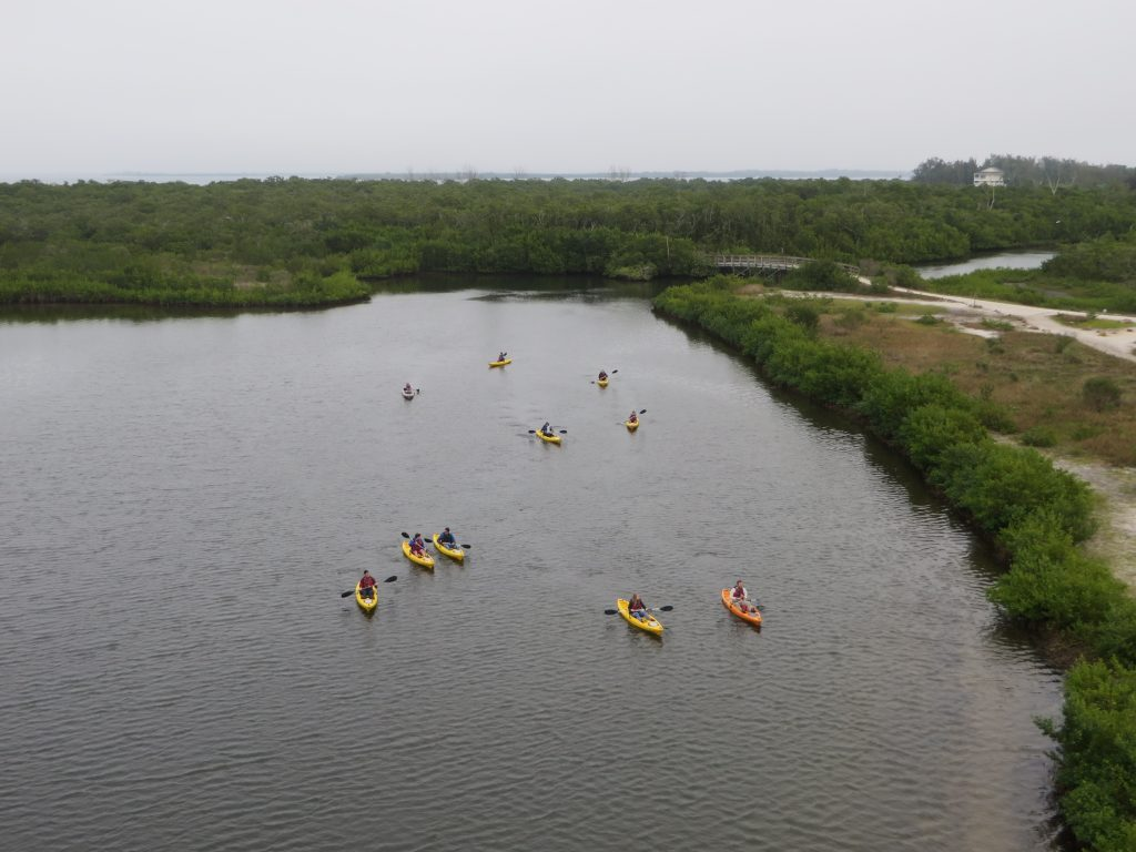 many kayaks on the water aerial view