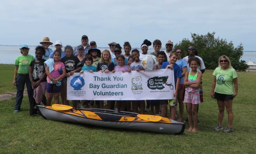 Volunteers holding up a Thank you Bay Guardians Volunteers sign
