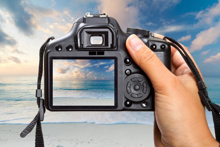 Photographer taking picture of beach