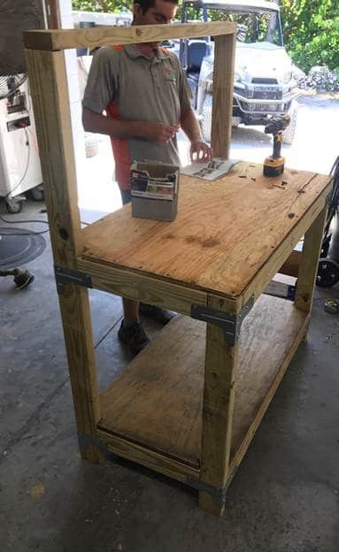 Jay Jaudon Putting The Finishing Touches On A New Workbench At Robinson Preserve