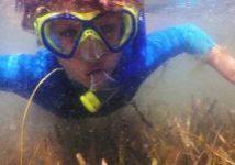 Boy underwater in snorkel mask