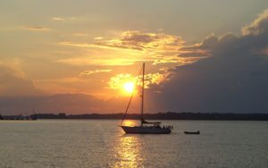 Recreational Boating Sailboat At Sunset
